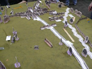 Photo 26 - This tabletop caught my eye because it did not have/use traditional figures or terrain. The troops and trees were made of paper. I regret not having questioned the judge on his approach, methodology, etc. Then again, it would have been rude to interrupt the game and participating generals.